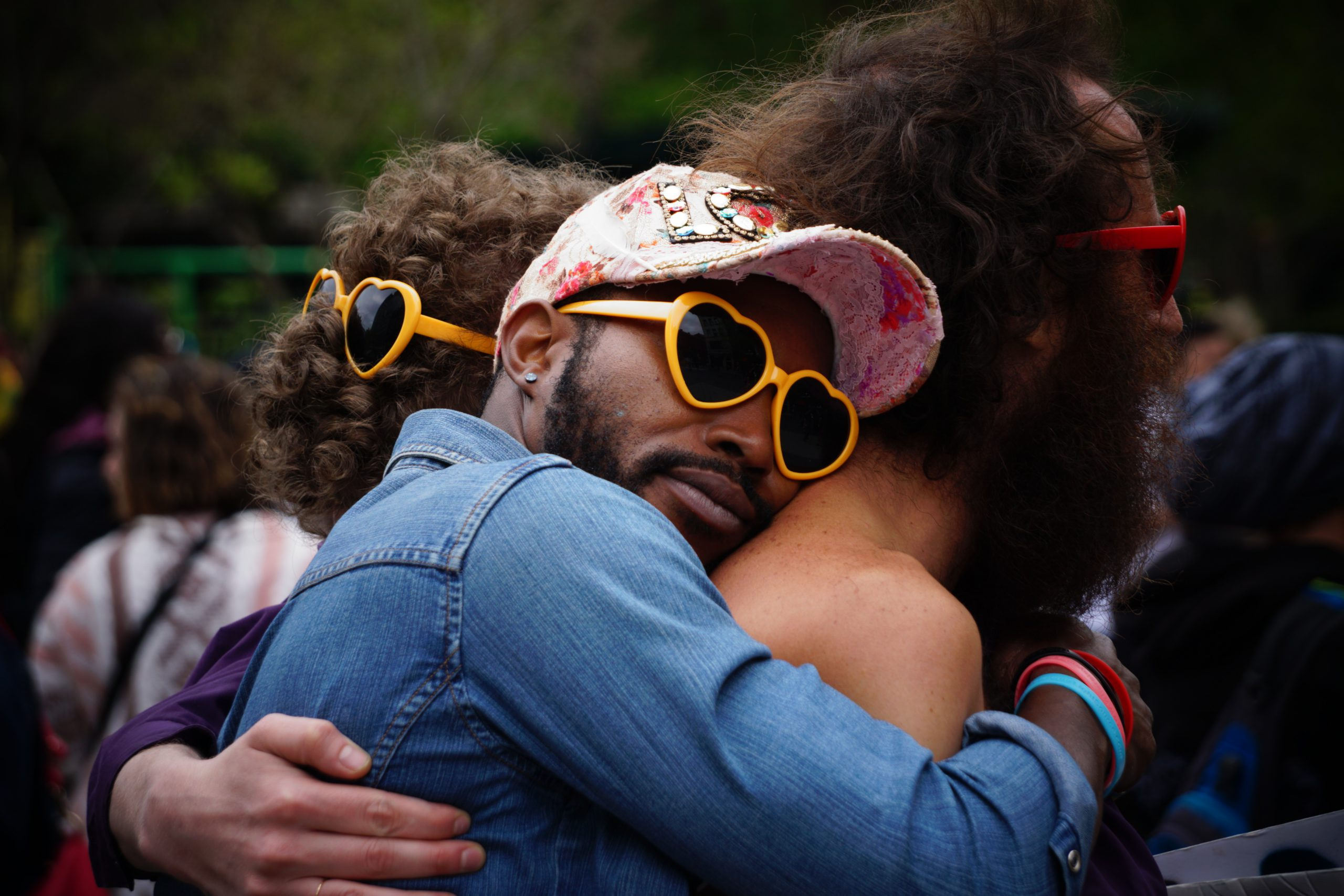 Guys hugging at festival