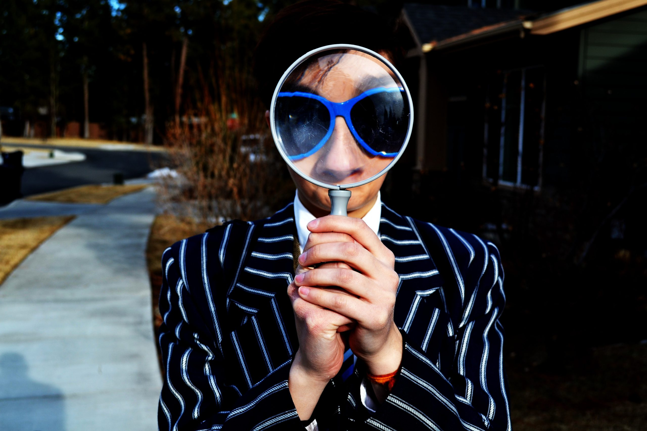 A staff recruiter looking through a magnifying glass.